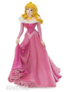 'You'll love me at once, the way you did once upon a dream.' Aurora wears her sparkling pink regal gown. A gorgeous Sleeping Beauty figurine for imaginative play and makes a cute cake topper for your Disney Princess party.