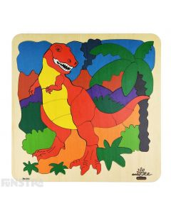 Vibrant and colourfully painted wooden jigsaw puzzle pieces create the fearsome Tyrannosaurus Rex standing in a prehistoric scene from the Jurassic world surrounded by palm trees and erupting volcano on this tiling puzzle.