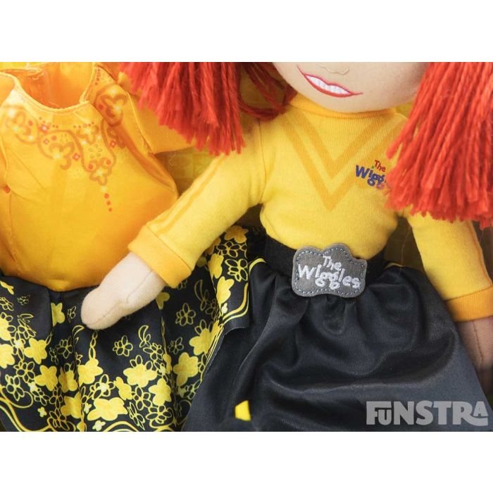 Wearing her yellow skivvy and black skirt, the doll even wears the official belt buckle