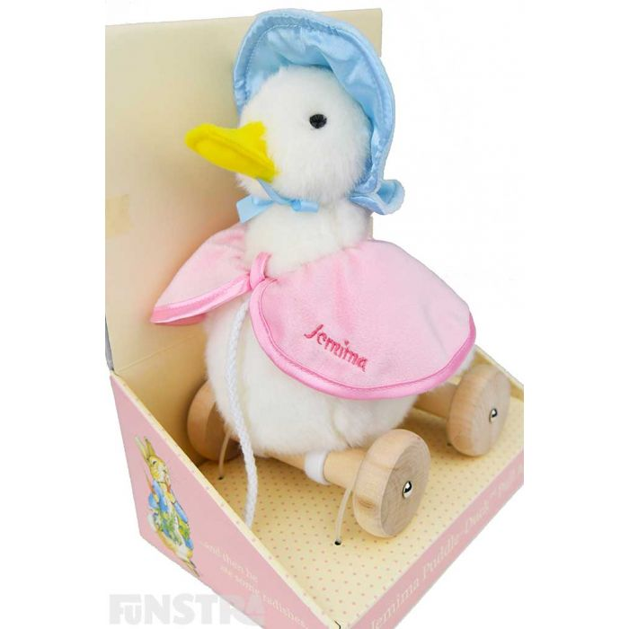 A gorgeous Jemima Puddle-Duck plush soft toy wears her signature blue poke bonnet and a pink shawl with 'Jemima' embroidered on it.