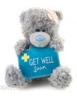 With bandages on Tatty Teddy head, this delightful teddy bear from Me to You holds a medical bag embellised with a medic cross and a 'Get Well Soon' message.