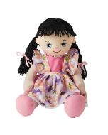 Emily is a wonderful rag doll with a soft cloth body and black plaited hair tied with pink ribbons and wears a floral purple dress and loves painting, arts and crafts.